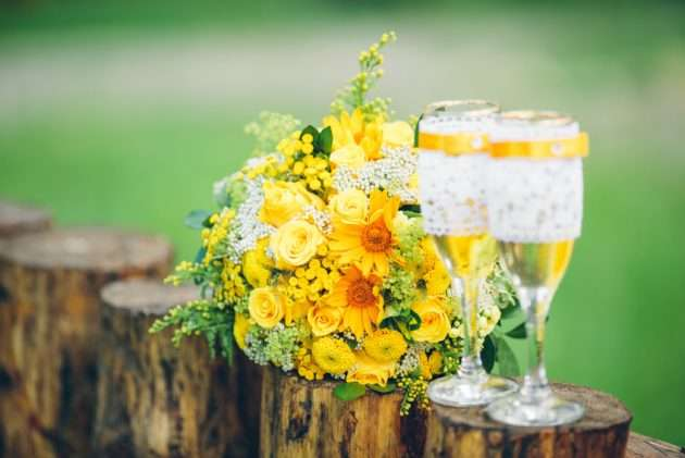 glass wine glasses and wedding yellow bouquet